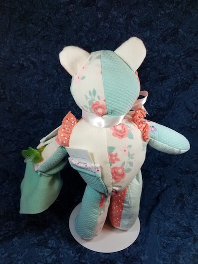 Back of Baby Memory Bear with a pocket to hold her Story Starter booklet.