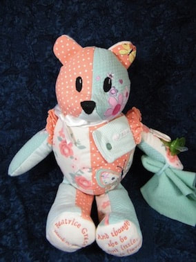 A competed memory Bear made from baby clothing and keepsakes.