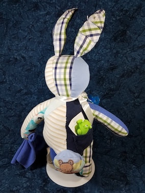 Back of Memory Bunny with a back pocket to hold it's Story Starter booklet and 3-D tail.