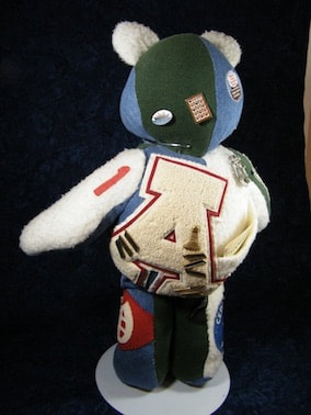 back of memory bear with college letter