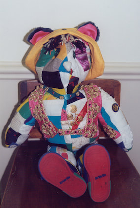 front of stuffed teddy bear made from family fabrics