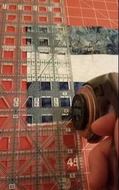 strips being cut using a rotary cutter and roller.