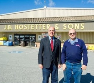Store front of JB Hostetter and Sons with the 2 Hostetter sons