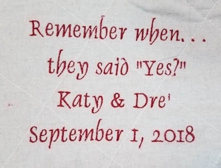 Red  embroidery on the back end of the keepsake Christmas tree skirt that reads Remember When. . . they said