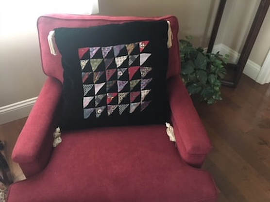Pillow made from black velvet and silk ties